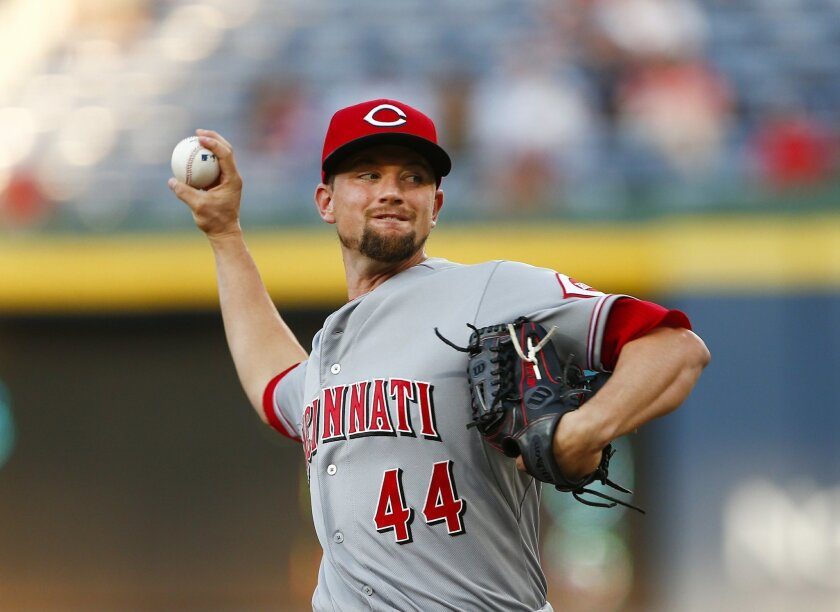 Cincinnati Reds starting pitcher Mike Leake works in the first inning of a baseball game against the Atlanta Braves Thursday, April 30, 2015, in Atlanta. (AP Photo/John Bazemore)