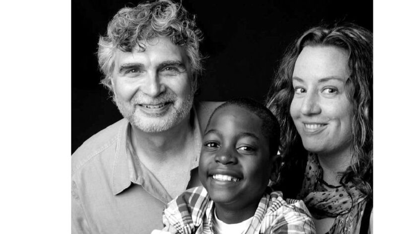 Maurice Possley, left, Cathleen Falsani and their son, Vasco, in a 2009 photo.