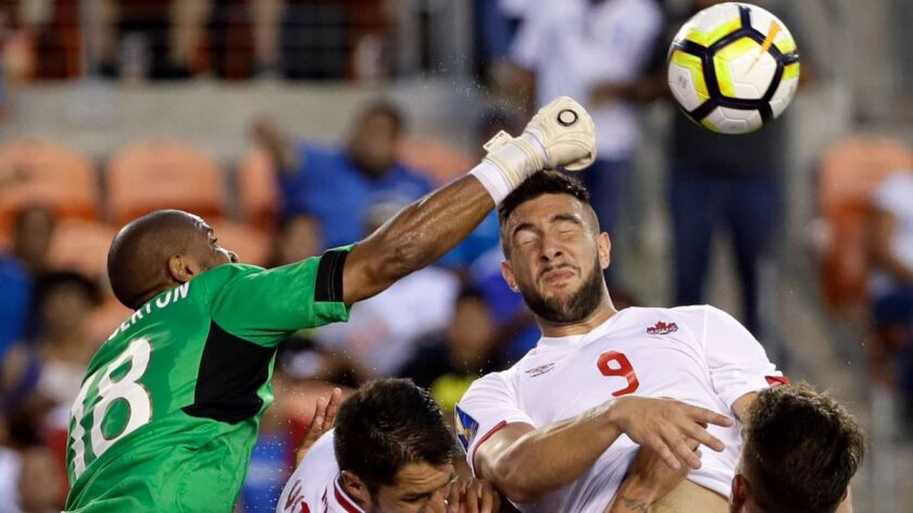 Costa Rica goalkeeper Patrick Pemberton (18) makes a save against Canada forward Lucas Cavallini (9) in the second half of a CONCACAF Gold Cup soccer match in Houston on Tuesday.