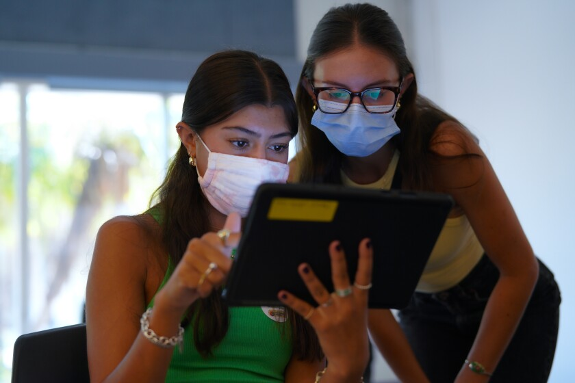 Natalia Castro (l) was vaccinated Thursday at Southwestern College. Her sister Celeste Castro (r) was vaccinated earlier.