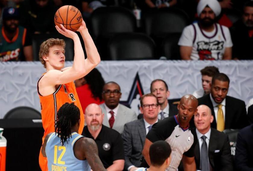 Lauri Markkanen (L) of The World Team takes a shot over Taurean Prince (2-L) of The US Team during the Rising Stars Game at Staples Center in Los Angeles, California , USA, 16 February 2018. EFE