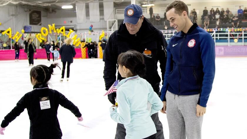 LAKEWOOD CA - JANUARY 31, 2018: U.S. Olympic figure skating coach Rafael Arutyunyan, left, and Olym