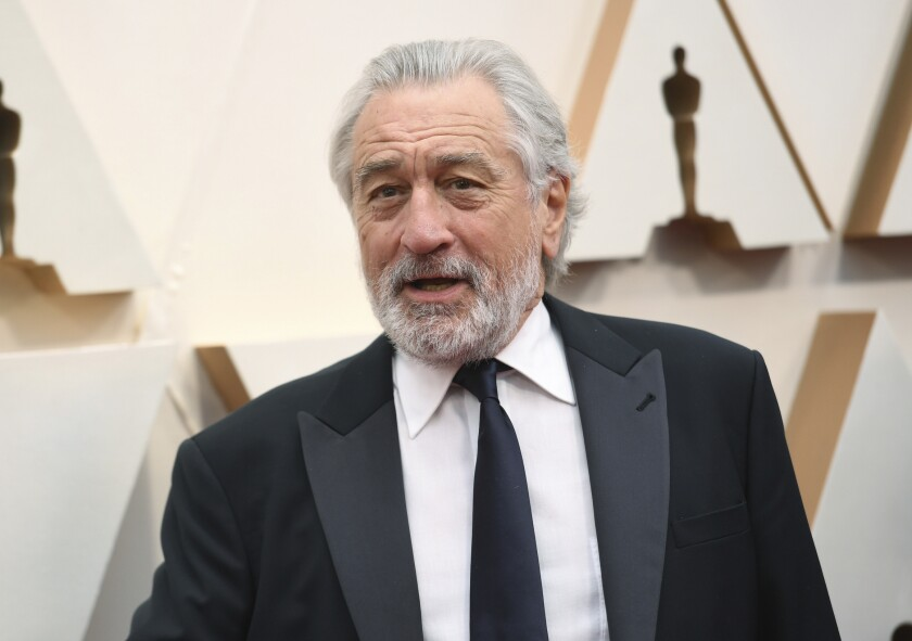 """FILE - Robert De Niro appears at the Oscars in Los Angeles on Feb. 9, 2020. A leg injury may keep De Niro from celebrating the 20th Anniversary of the Tribeca Film Festival in person. The accident happened last week in Oklahoma while on location for the upcoming Martin Scorsese film, """"Killers of the Flower Moon."""" (Photo by Richard Shotwell/Invision/AP, File)"""