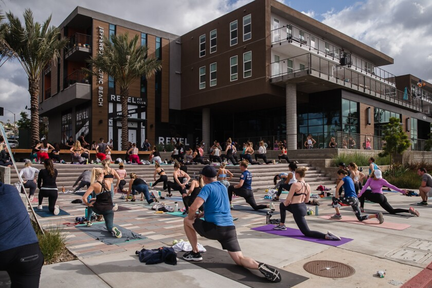 People workout outside of REVEL Fit Club in Pacific Beach on December 31, 2020.