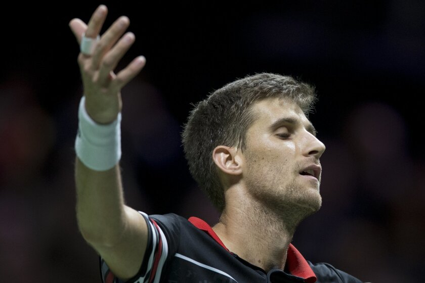Slovakia's Martin Klizan celebrates winning the final against France's Gael Monfils in three sets, 6-7 (1-7), 6-3, 6-1, at the ABN AMRO world tennis tournament at the Ahoy arena in Rotterdam, Netherlands, Sunday, Feb. 14, 2016. (AP Photo/Peter Dejong)
