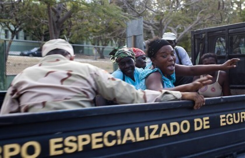 In this photo taken on Jan. 29, 2011, a group of detained Haitian women are driven away by Dominican specialized military border officers in Jimani, Dominican Republic. The largest campaign in years to deport Haitians living illegally in the Dominican Republic is causing widespread fear and prompti