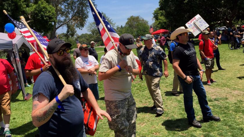Supporters of President Trump join a Make America Great Again rally at Mile Square Regional Park in Fountain Valley on Saturday.