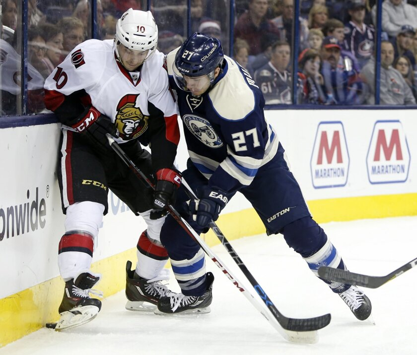 Ottawa Senators' Shane Prince, left, and Columbus Blue Jackets' Ryan Murray fight for the puck during the first period of an NHL hockey game Saturday, Feb. 13, 2016, in Columbus, Ohio. (AP Photo/Jay LaPrete)