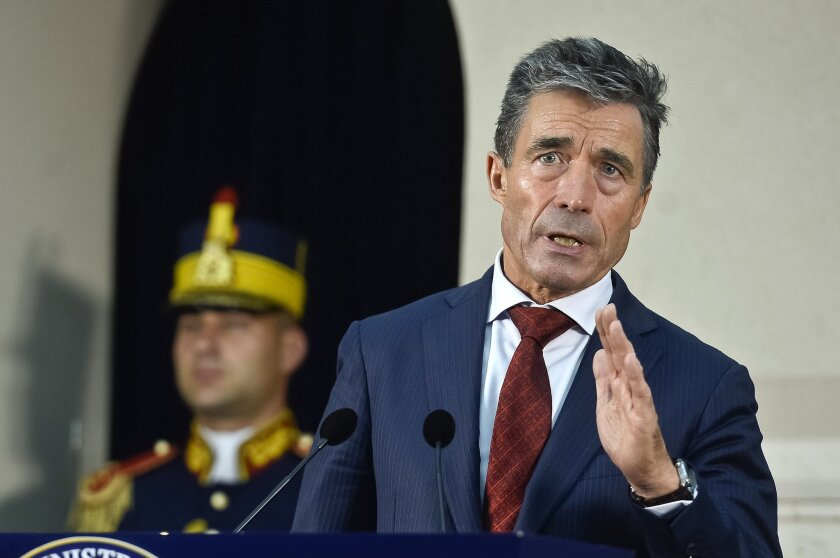 FILE - In this Friday, May 16, 2014, file photo, NATO Secretary General Anders Fogh Rasmussen speaks during a joint briefing with Romanian President Traian Basescu, at the Cotroceni presidential palace in Bucharest, Romania. Faced with a newly aggressive Russia, NATO has been mulling how to react, but it is ruling out one option: rapid expansion. (AP Photo/Octav Ganea, Mediafax, File) ROMANIA OUT