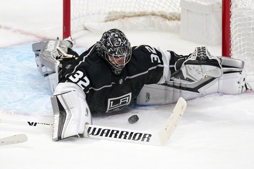 Kings goaltender Jonathan Quick stops a shot during the third period against the Minnesota Wild.
