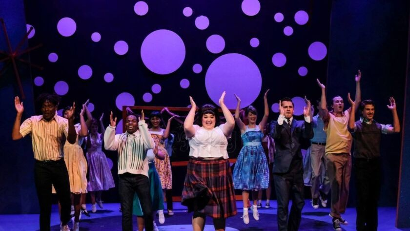 """Bethany Slomka, center, leads the cast of San Diego Musical Theatre's """"Hairspray"""" at the Horton Grand Theatre."""