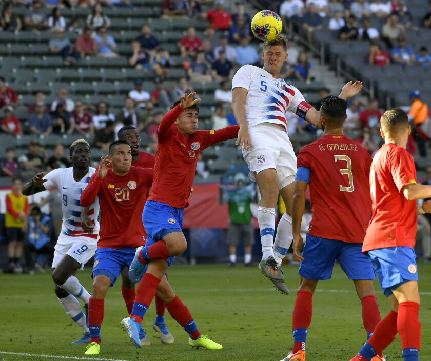 Walker Zimmerman of the United States heads the ball toward the goal during an exhibition match against Costa Rica on Feb. 1 at Dignity Health Sports Park.