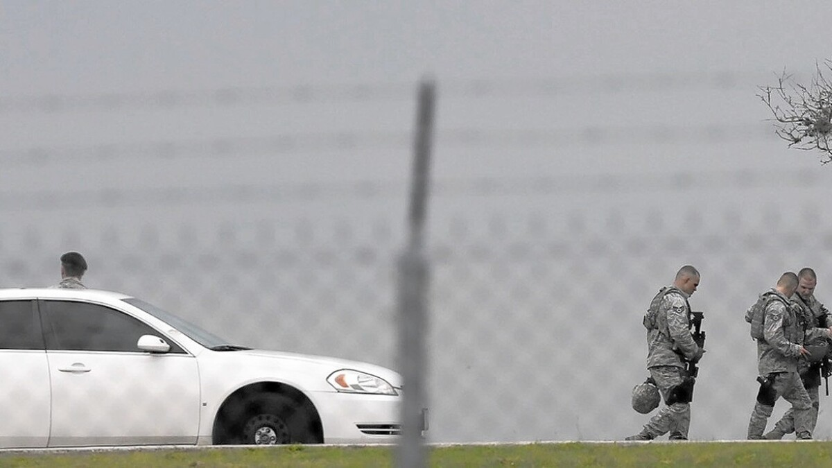 Gunman in Texas Air Force base killing had gone AWOL, then