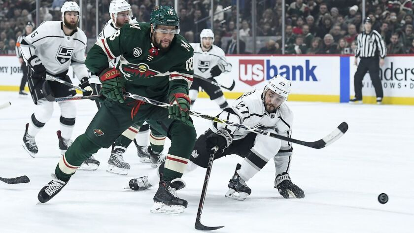 The Minnesota Wild's Jordan Greenway attempts a shot while being defended by the Kings' Alec Martinez in the first period at Xcel Energy Center in Minneapolis on Jan. 15.