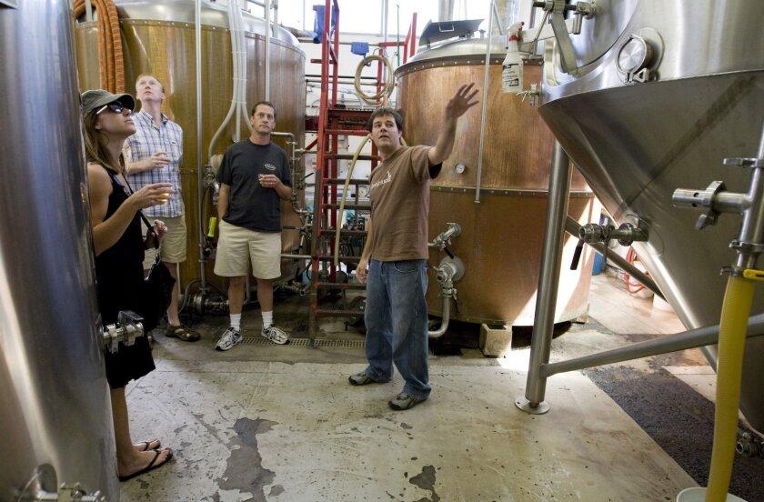 Jon McDermott, right. leads a tour through Green Flash's Vista brewery in 2008.