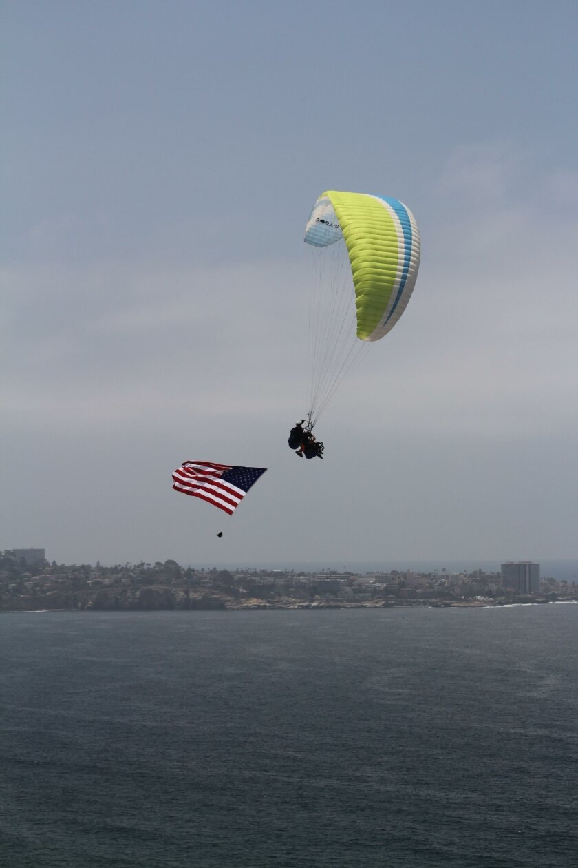 Elliot and instructor J.C. Perren glide over the La Jolla sky with an american flag.