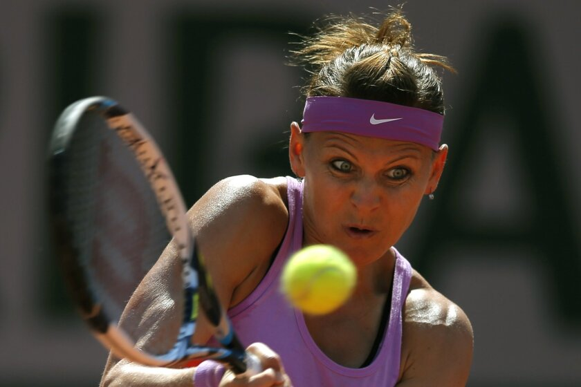 Lucie Safarova of the Czech Republic returns in the semifinal match of the French Open tennis tournament against Serbia's Ana Ivanovic at the Roland Garros stadium, in Paris, France, Thursday, June 4, 2015. (AP Photo/Francois Mori)