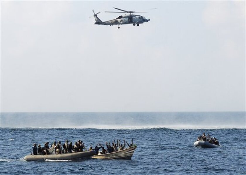 In this photo released by the U.S. Navy, search and seizure crews, left and right, from the guided-missile cruiser USS Vella Gulf close in on inflatable boats Thursday, Feb. 12, 2009 in the Gulf of Aden to apprehend suspected pirates. The Navy says the Vella Gulf intercepted and caught nine suspected pirates Thursday after the crew of an Indian-flagged ship said it had been fired on and people were attempting to board the vessel. In a similar incident Wednesday, the Navy seized seven suspected pirates. (AP Photo/U.S. Navy, Petty Officer 2nd Class Jason R. Zalasky)