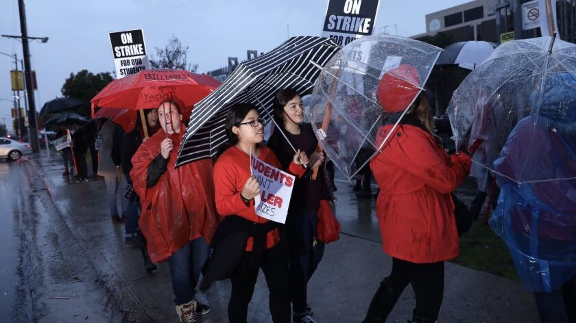 Students join LAUSD teachers in from of Roosevelt High School Monday morning as teachers walked off the job in their first strike in 30 years.