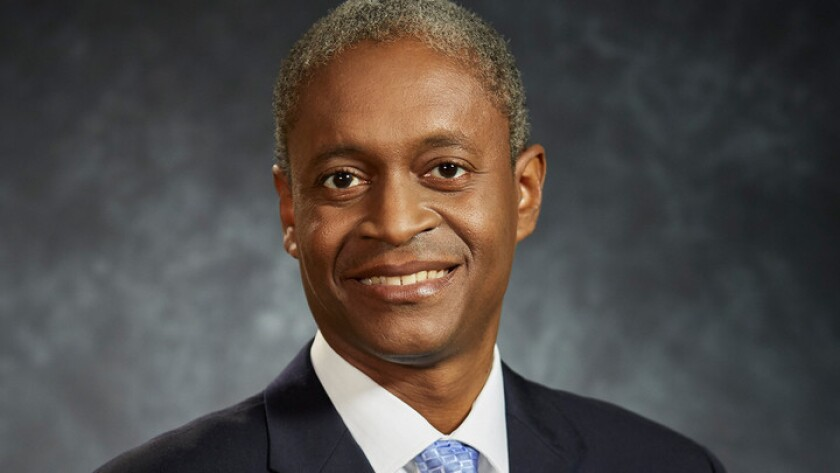 Raphael Bostic was named Monday as president of the Federal Reserve Bank of Atlanta.