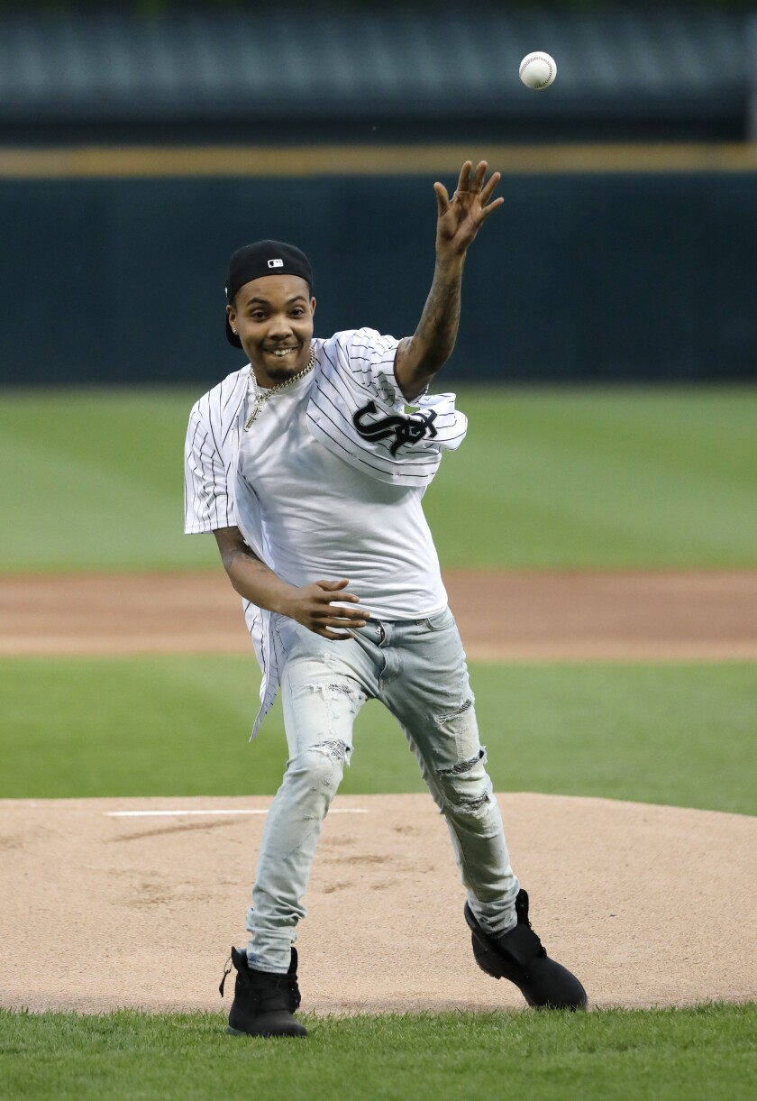 FILE — This June 11, 2019 file photo, Chicago rapper G Herbo throws a ceremonial first pitch before a baseball game between the Chicago White Sox and the Washington Nationals in Chicago. Federal prosecutors announced Wednesday, May 5, 2019 that the Chicago native, whose real name is Herbert Wright III, was charged with lying to federal investigators. In December, the 25-year-old G Herbo was among six people, including his promoter, indicted for conspiracy to commit wire fraud and aggravated identity theft. (AP Photo/Charles Rex Arbogast, File)