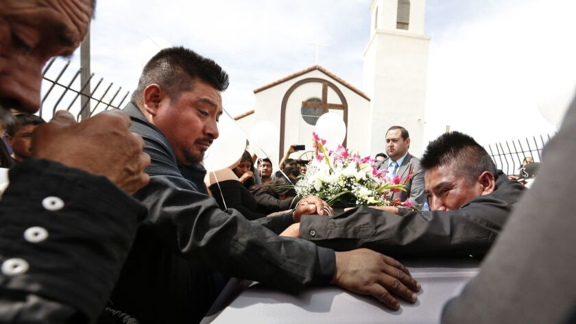 Funeral services are held for Santos Hilario Garcia and Marcelina Garcia Profecto at Our Lady of Guadalupe Church in Delano, Calif., on April 2.