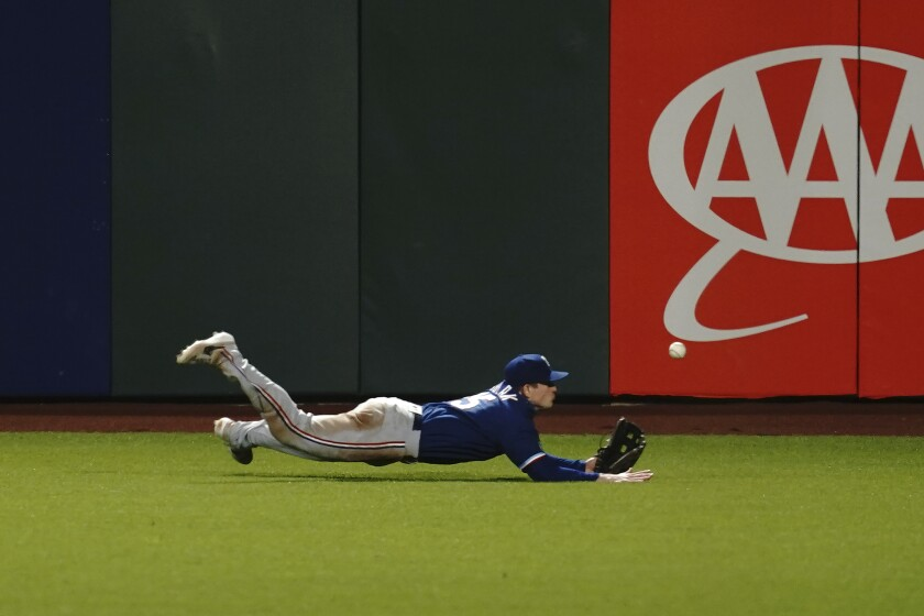 Texas Rangers' Nick Solak cannot catch San Francisco Giants' Darin Ruf's two-run double during the seventh inning of a baseball game in San Francisco, Friday, July 31, 2020. (AP Photo/Jeff Chiu)