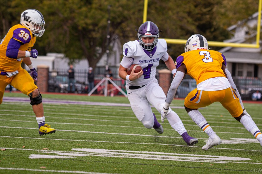 Greg Cagle runs with ball for Southwestern College, an NAIA school in Kansas.