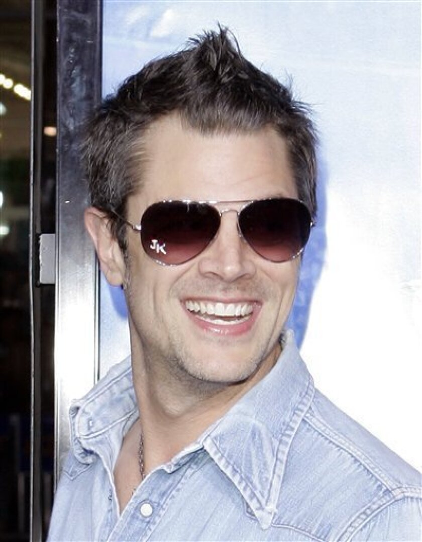 """In this March 28, 2007, file photo, actor Johnny Knoxville poses as he arrives at the Los Angeles premiere of """"Blades of Glory,"""" in the Hollywood area of Los Angeles.  (AP Photo/Mark J. Terrill, file )"""