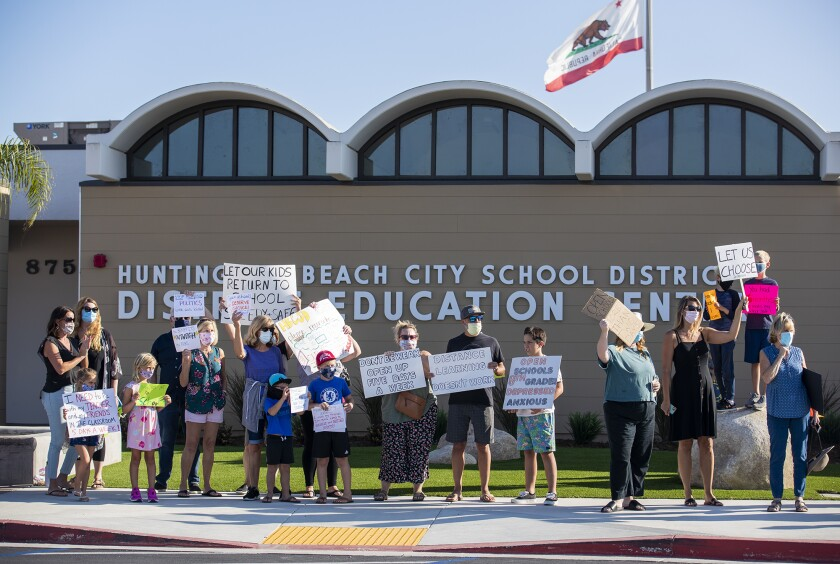 Parents and students hold a rally at the Huntington Beach City School District on Sept. 22