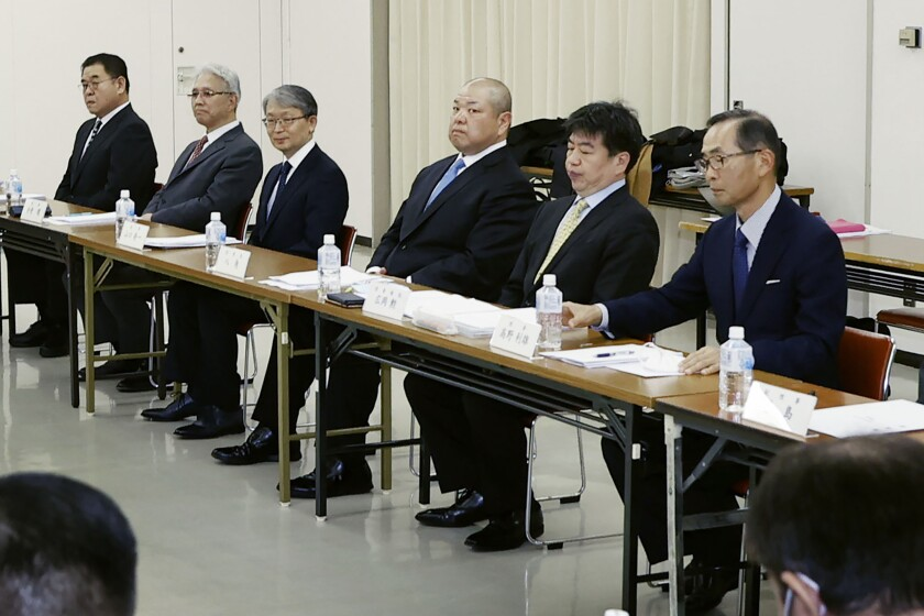Japan Sumo Association Chairman Hakkaku, fourth from left, attends an extraordinary board meeting on the next Spring Sumo Tournament in Osaka, western Japan, Sunday, March 1, 2020. On Sunday, national broadcaster NHK reported that officials of the Japan Sumo Associating decided to hold the March 8-22 spring grand sumo tournament in Osaka with no spectators. (Yosuke Mizuno/Kyodo News via AP)