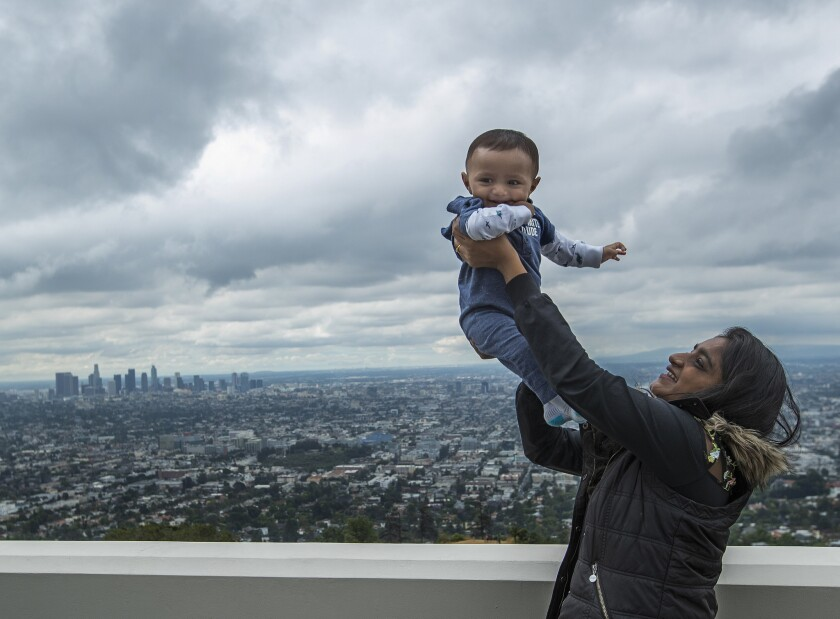 LOS ANGELES, CA-JUNE 21, 2019: Tejal Patel, 19, takes in the view with her cousin Smit Patil(cq), 8