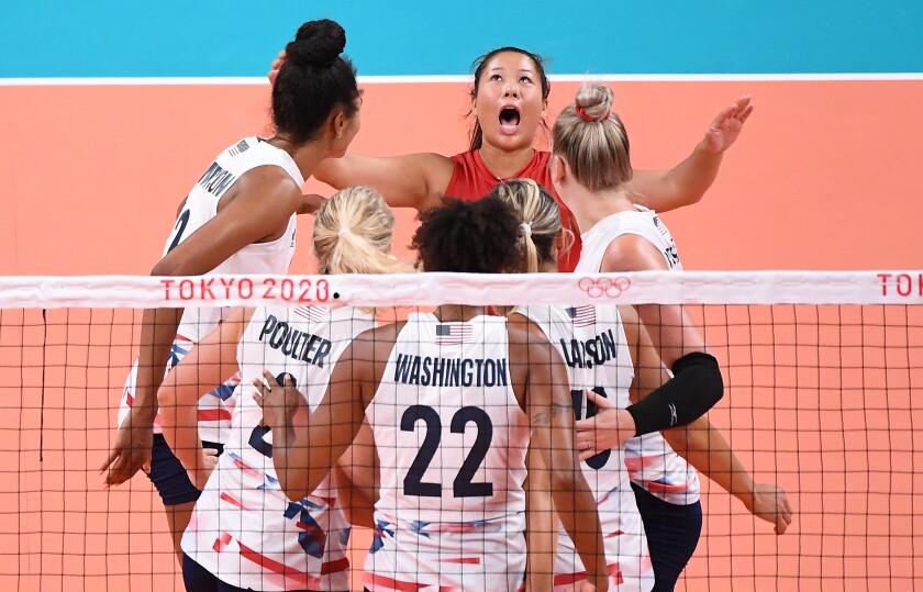 U.S. libero Justine Wong-Orantes celebrates a point with her teammates.