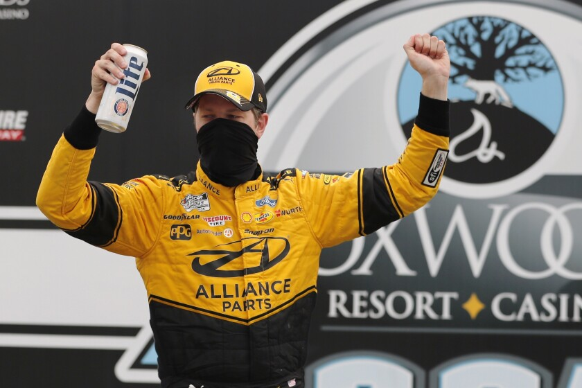 Driver Brad Keselowski celebrates after winning a NASCAR Cup Series auto race, Sunday, Aug. 2, 2020, at the New Hampshire Motor Speedway in Loudon, N.H. (AP Photo/Charles Krupa)