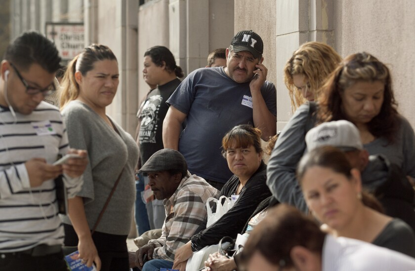Residents wait in line at Community Coalition to sign up for health insurance last November. SEIU United Healthcare Workers West invited the public to enroll for Medi-Cal and Covered California coverage.
