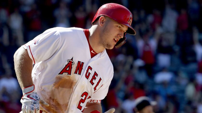 ANAHEIM, CALIF. - JULY 22, 2018. Angels center fielder Mike Trout rounds the bases after hitting a
