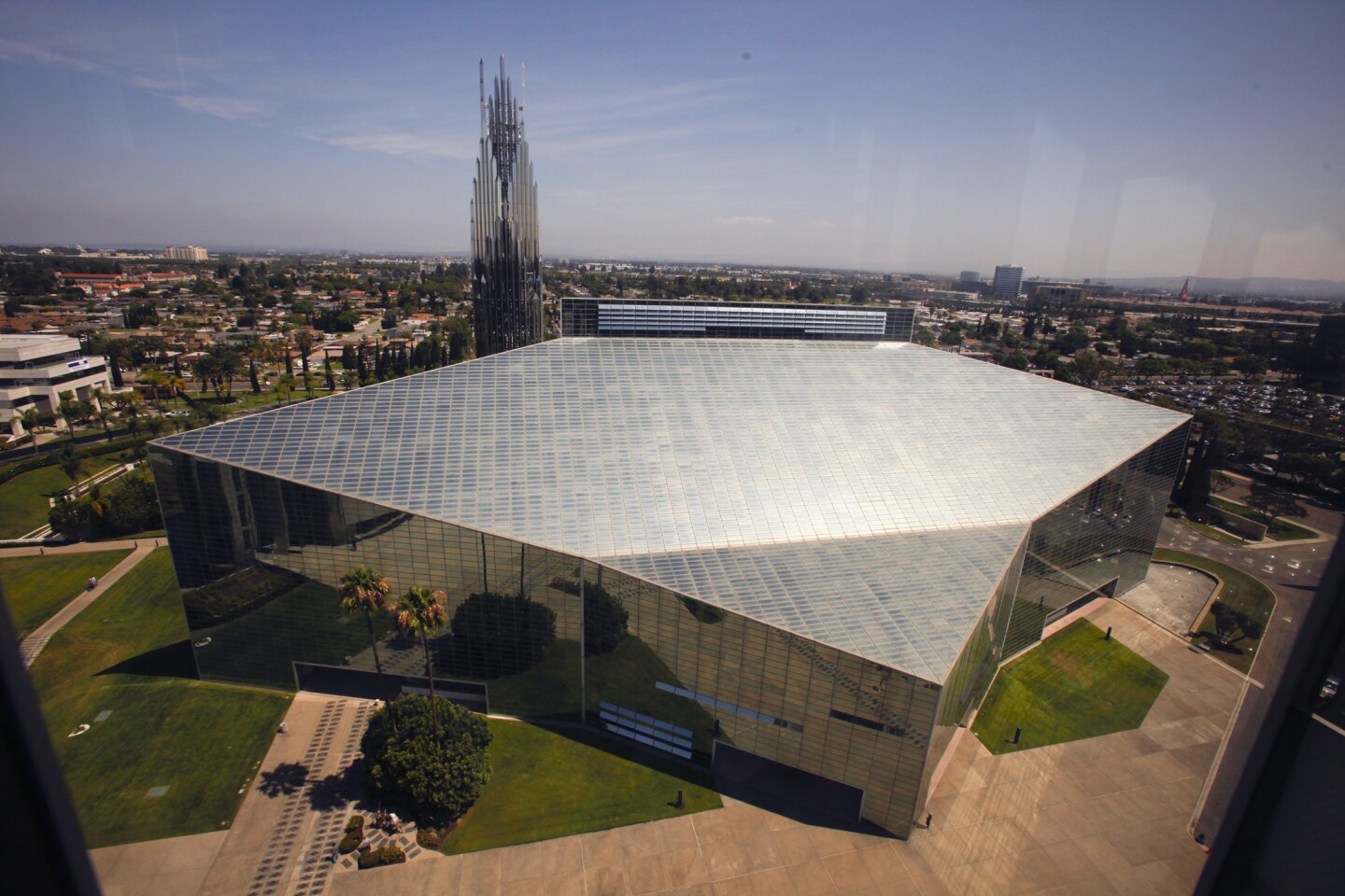 The former Crystal Cathedral in Garden Grove is being transformed into the Christ Cathedral by the Roman Catholic Diocese of Orange. The 415-foot-long cathedral, designed by famed architect Philip Johnson, is covered by about 10,000 windows and will eventually be retrofitted on the inside to accommodate traditional Catholic Church layout and rituals.