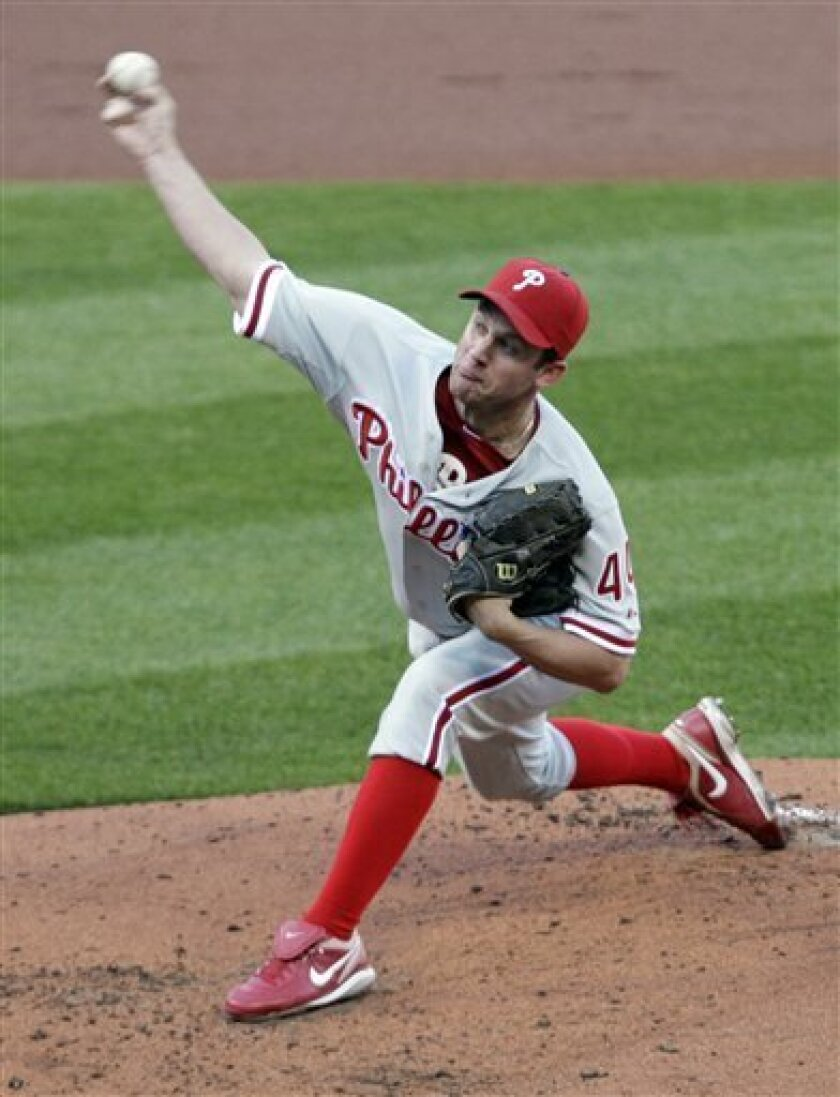Philadelphia Phillies starting pitcher Roy Oswalt throws during the first inning of Game 4 of baseball's National League division series against the St. Louis Cardinals, Wednesday, Oct. 5, 2011, in St. Louis. (AP Photo/Tom Gannam)