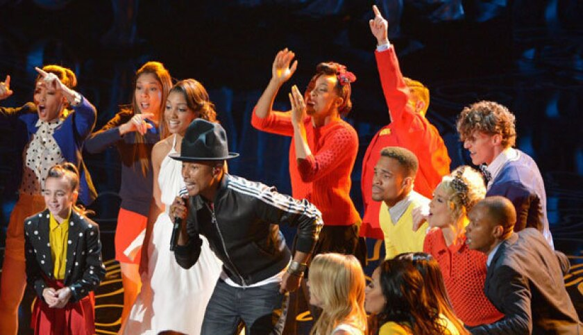 Pharrell Williams and his hat perform