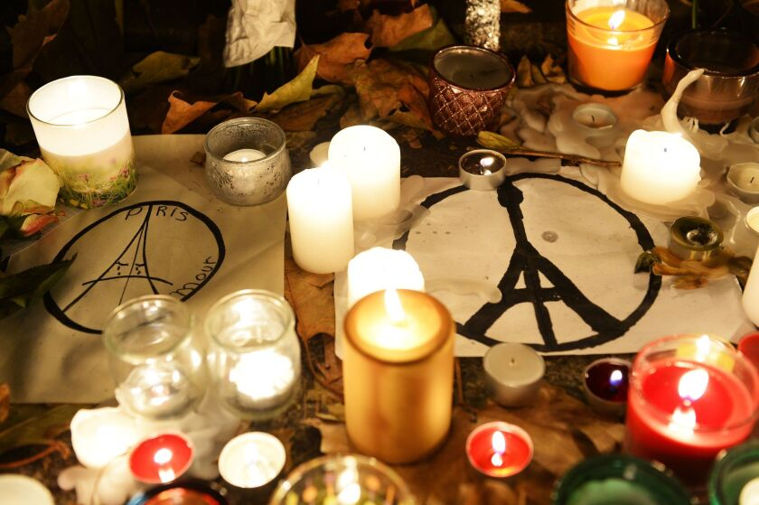 Candles and messages are left at a makeshift memorial next to the Bataclan concert hall in Paris.