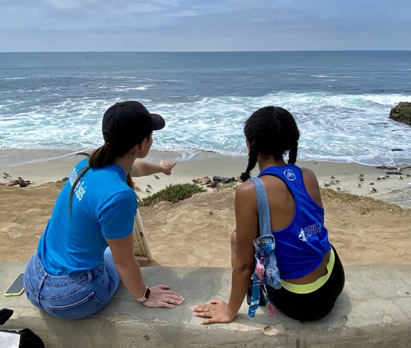 Miss Earth USA 2021 Marisa Butler (left) and Miss Teen Earth USA Katia Gerry observe sea lions July 25 in La Jolla.