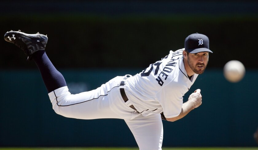 FILE - In this May 18, 2016, file photo, Detroit Tigers pitcher Justin Verlander throws a warm-up pitch against the Minnesota Twins in the second inning of a baseball game in Detroit. Verlander tweeted early in the month that he was on the verge of dominating. Then he went out and backed up those b