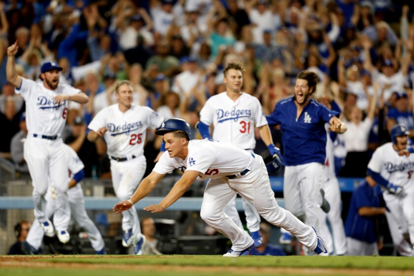 Dodgers shortstop Corey Seager dives in to score the winning run against the Giants on an Adrian Gonzalez double in the bottom of the ninth.