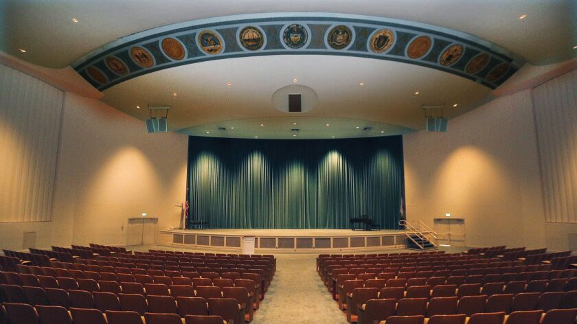 The auditorium with the state seals of the original thirteen colonies on the ceiling at Forest Lawn