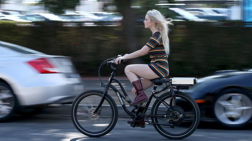 Orange County transplant Christiana Crabbe rides an e-bike through her new L.A. neighborhood.