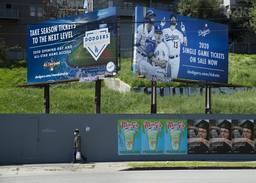 Billboards on Sunset Boulevard near the entrance to Dodger Stadium advertise season tickets and individual game tickets.