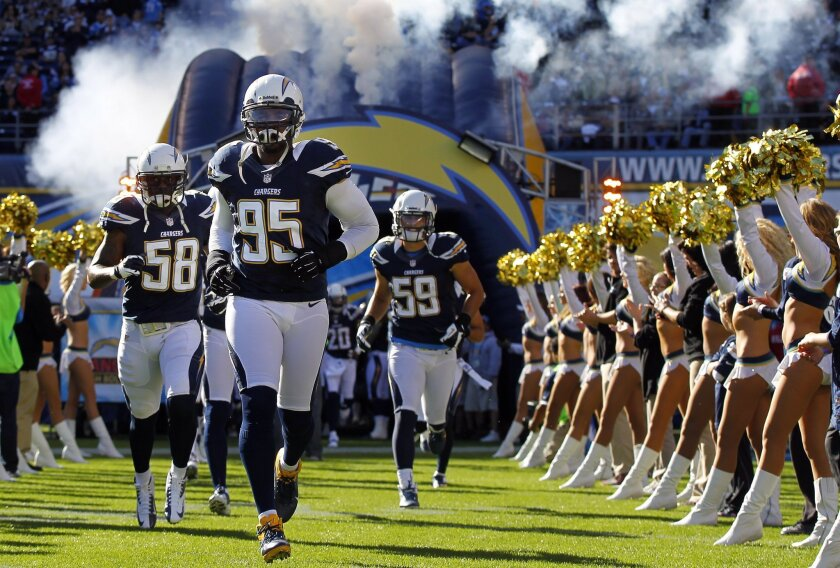 Chargers Shaun Phillips leads the defense out before the Bengals game on Sunday, Dec. 2, 2012.