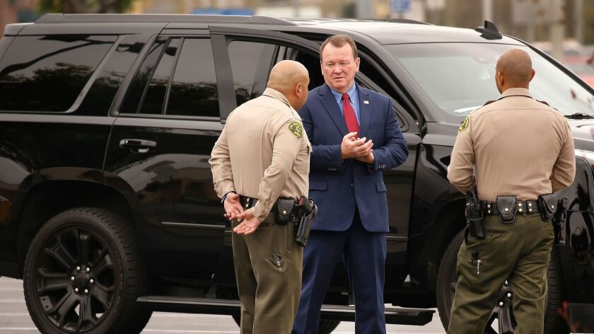 Los Angeles County Sheriff Jim McDonnell talks to deputies in Temple City in March.