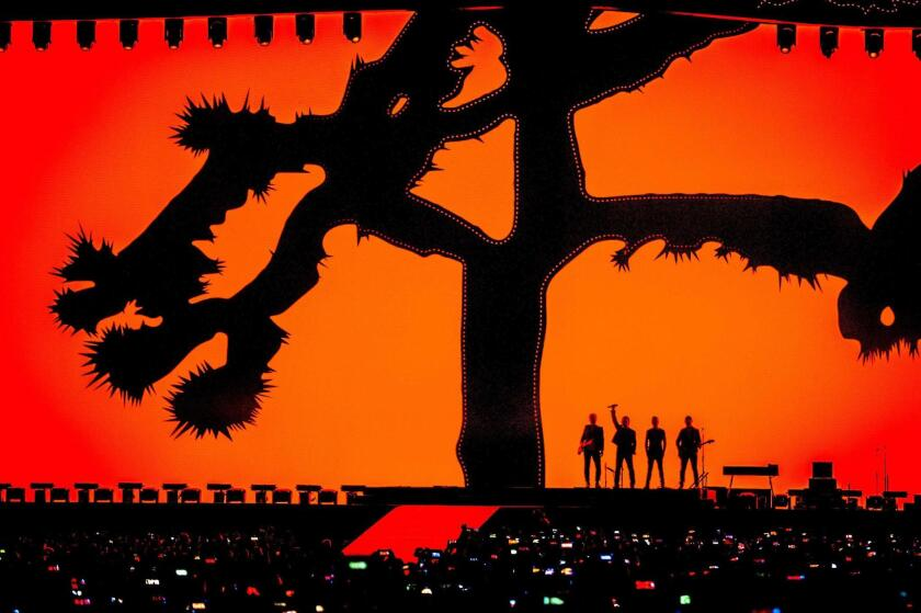 U2 performs on stage in Amsterdam