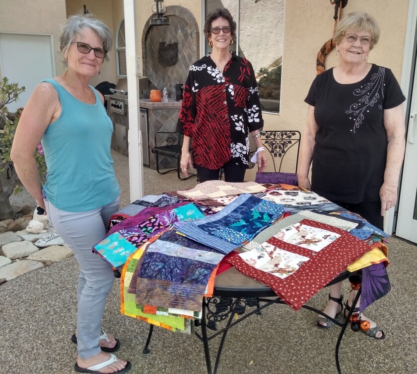 Community Piece Makers participants displaying their bags are, from left, Dianna Webb, Carol Spencer and Joanne Bowden.